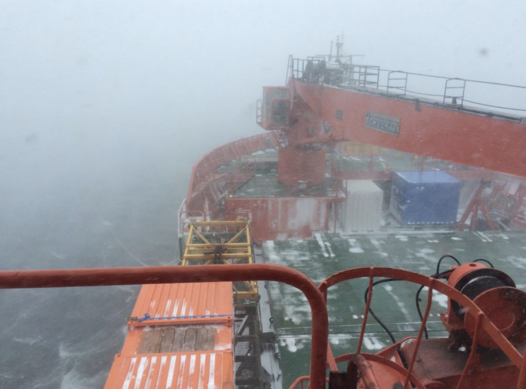 View from the bridge deck of Australia's icebreaker the Aurora Australis, during a blizzard in Horseshoe Harbour at Mawson station Photo Rob King